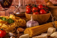 Products for cooking - pasta, tomatoes, garlic, olive oil and re Royalty Free Stock Images