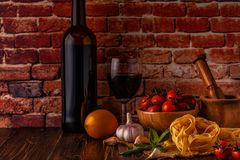 Products for cooking - pasta, tomatoes, garlic, olive oil and re Royalty Free Stock Image