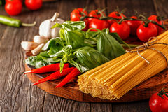 Products for cooking - pasta, tomatoes, garlic, pepper, and basi Stock Photo
