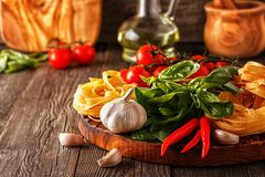 Products for cooking - pasta, tomatoes, garlic, pepper, and basi Stock Image