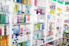 Products Displayed In Shelves At Pharmacy. Defocused image of products displayed in shelves at pharmacy Stock Photography