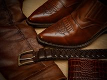Products from a genuine leather, shoes, jacket, belt Royalty Free Stock Photos