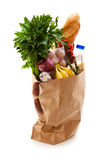 Products in grocery bag. Stock Photos