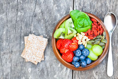Products for a healthy breakfas berries  fruits nuts and granola Royalty Free Stock Images
