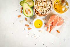 Products with healthy fats. Healthy food. Products with healthy fats. Omega 3, omega 6. Ingredients and products: trout salmon, flaxseed oil, avocado, almonds Stock Photography