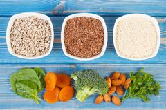 Products and ingredients containing calcium and dietary fiber, concept of healthy nutrition. Ingredients or products containing calcium and dietary fiber stock image