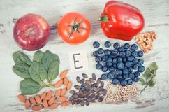 Products and ingredients containing vitamin E and dietary fiber, healthy nutrition concept. Products or ingredients containing vitamin E and dietary fiber royalty free stock image