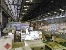 Products in a large warehouse.Within a large old warehouse royalty free stock photography