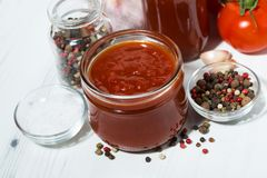 Products made with fresh tomato - sauce, juice and seasonings. On white table, top view horizontal stock photos