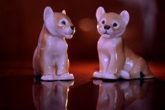 Porcelain products - little lion cubs. stock image