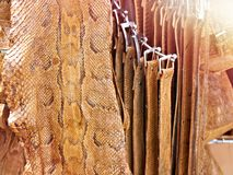 Products made of snake skin on market. Products made of snake skin on the market royalty free stock photos