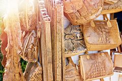 Products of snake skin on market. Products made of snake skin on the market stock photo