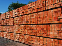 Products manufactory. Just made red bricks stacked in several rows for sale stock images