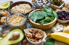 Products rich of potassium and magnesium. Bananas, spinach, nuts, grains, dried fruits, beans and avocado. healthy food stock images