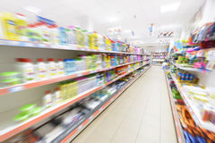Products in row in a supermarket Stock Photos