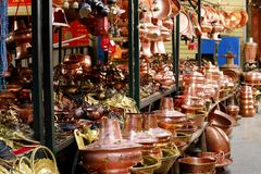 Pots and other copper objects in a village market near the historic city of Lijiang, Yunnan, China royalty free stock photo