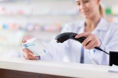 Produit de balayage de pharmacien image libre de droits