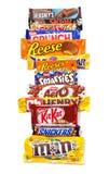 Produits assortis de chocolat dans une ligne Images libres de droits