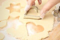 Produrre i biscotti di natale Fotografia Stock