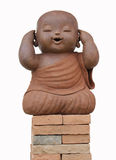 Produto de cerâmica da monge da criança isolado no fundo branco Foto de Stock Royalty Free