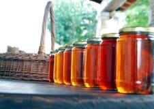 Produto do país - frascos do mel Fotografia de Stock