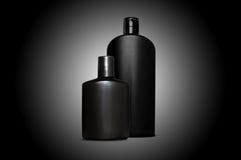 Produtos de cuidado de pele pessoais para homens sobre o preto Imagem de Stock Royalty Free