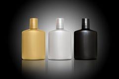 Produtos de cuidado de pele pessoais para homens sobre o preto Fotografia de Stock