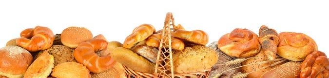 Produtos do pão e da padaria isolados no fundo branco Panorami foto de stock