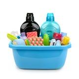 Produtos e detergentes de higiene na bacia Imagem de Stock Royalty Free