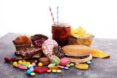 Produtos insalubres mau do alimento para a figura, a pele, o coração e os dentes imagem de stock royalty free