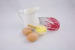 Produtos lácteos da manteiga dos ovos e ingrediente do cozimento Fotografia de Stock