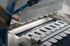 Produzione della copertura di plastica del contenitore di succo Fotografia Stock
