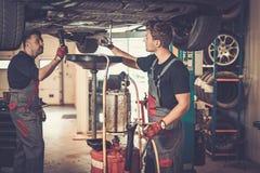 Profecional car  mechanic changing motor oil in automobile engin Stock Photo