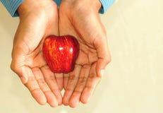 Businessman holding apple  Royalty Free Stock Image