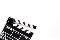 Profesión del cineasta Clapperboard en el copyspace blanco de la opinión superior del fondo imagen de archivo libre de regalías