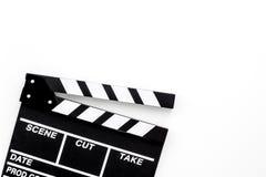 Profesión del cineasta Clapperboard en el copyspace blanco de la opinión superior del fondo Imágenes de archivo libres de regalías