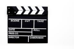 Profesión del cineasta Clapperboard en la opinión superior del fondo blanco imagen de archivo