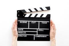 Profesión del cineasta Clapperboard en la opinión superior del fondo blanco fotografía de archivo