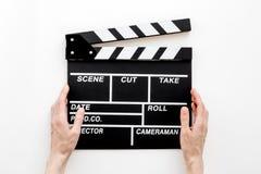 Profesión del cineasta Clapperboard en la opinión superior del fondo blanco fotos de archivo libres de regalías