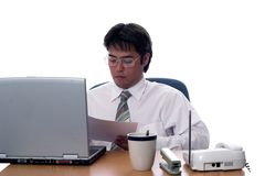 The profesional. Young asian businessman working hard Stock Image