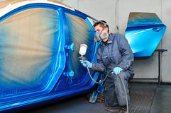 Profesional car painter. Royalty Free Stock Image