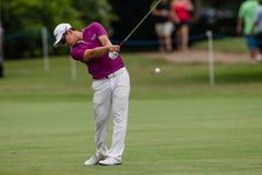 Profesional Jin Jeong Swinging del golf Fotografía de archivo libre de regalías