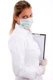 Profesional médico con la pista y la máscara de escritura Fotografía de archivo libre de regalías