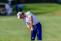 Profesional Matteo Manaserro Swinging del golf Foto de archivo libre de regalías