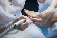 Profesional nail technician sanding nails with machine Royalty Free Stock Photo