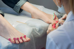 Profesional nail technician sanding nails with machine Royalty Free Stock Image