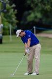 Profesional Thomas Aiken Swinging del golf Fotografía de archivo libre de regalías
