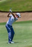 Profesional Tommy Fleetwood Swinging del golf Imagen de archivo libre de regalías