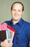 Profesor con los libros Imagen de archivo