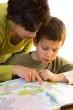 Profesor de la geografía con el niño Imagen de archivo